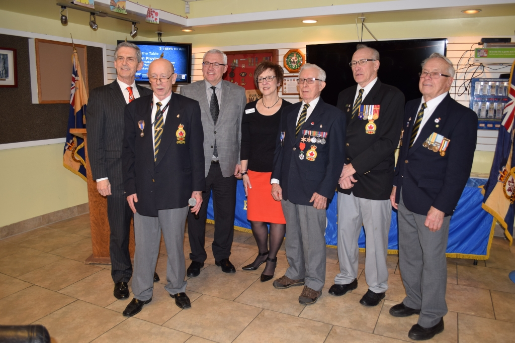 (Left to right) MLA Simon Gibson, Legion President Brian Mills, Mayor Henry Braun, Councillor Sandy Blue, veteran Cyril Holbrow, veteran Dan Norgaard and veteran John Molnar.